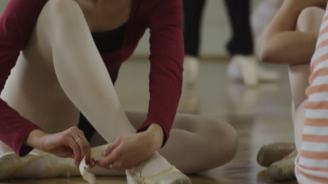 ballerina putting on pointe shoes - dance studio stock videos & royalty-free footage