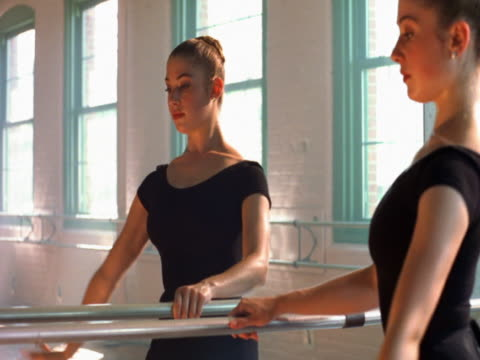 ballerina stretching on barre - barre stock videos and b-roll footage