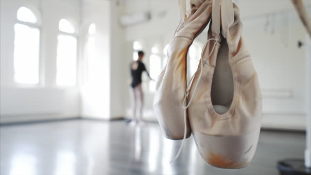 ballerina stretching up. - ballet shoe stock videos and b-roll footage