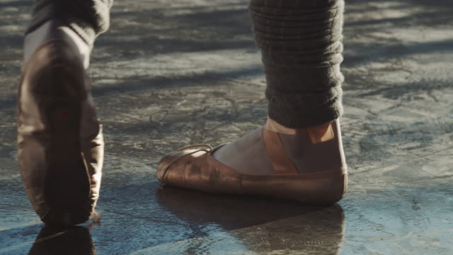 ballerina trying to balance on toes in studio - ballet shoe stock videos and b-roll footage