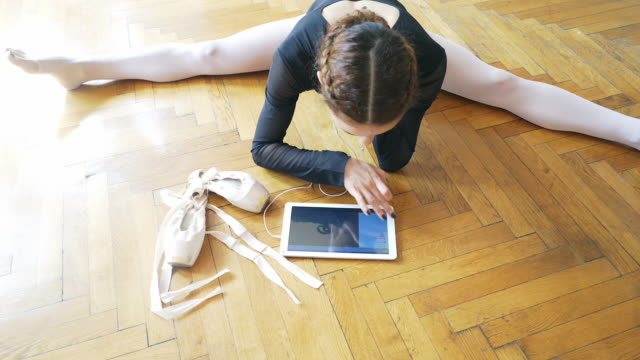 ballerina using a digital tablet. - legs apart stock videos & royalty-free footage