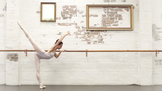 ballerina warms up in the studio - dance studio stock videos & royalty-free footage