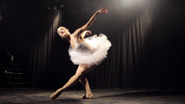 ws ballerina wearing tutu dancing on stage / new york city, new york, usa - ballerina stock-videos und b-roll-filmmaterial