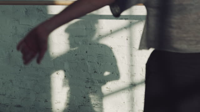 ballerina with shadow on wall during rehearsal - barre stock videos & royalty-free footage