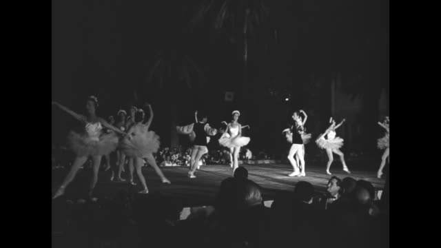 ws ballerinas and two ballet dancers perform at the grand hotel garden party held to open the cannes film festival audience watches in foreground - ballet dancing stock videos & royalty-free footage