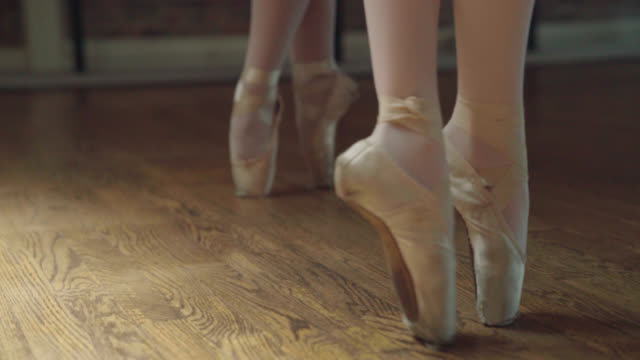 ballerinas on toes - relevé - ballet dancer stock videos and b-roll footage