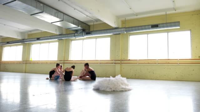 ballerinas sitting on floor tying pointe shoes - dance studio stock videos & royalty-free footage