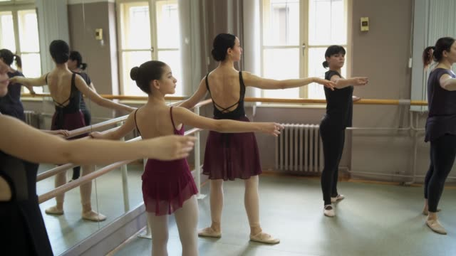 ballerinas working on thire postures - tutu stock videos & royalty-free footage