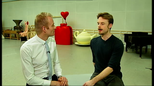 alice in wonderland production close shot of pointe shoes and leg warmers of ballet dancers as along christopher wheeldon interview sot reporter to... - swan lake stock videos & royalty-free footage