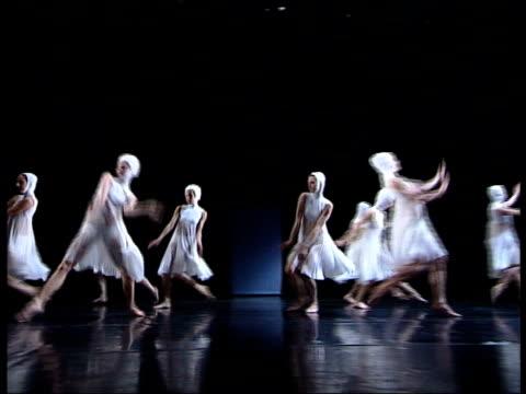 stockvideo's en b-roll-footage met ballet based on einstein's theory of relativity england london members of rambert dance company performing dance based on einstein's theory of... - e=mc2