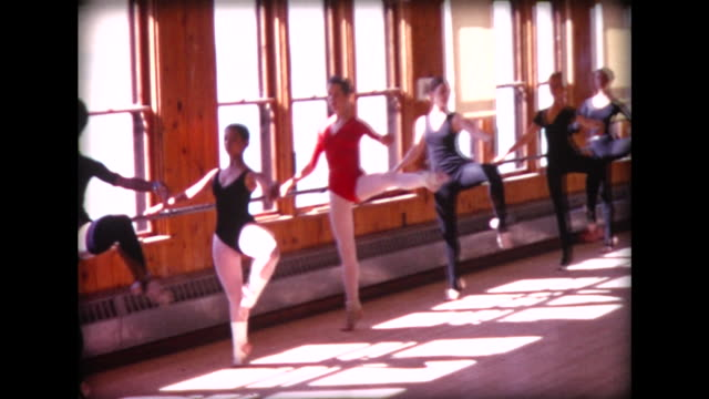 1974 ballet class in sunlit studio - ballerina stock-videos und b-roll-filmmaterial