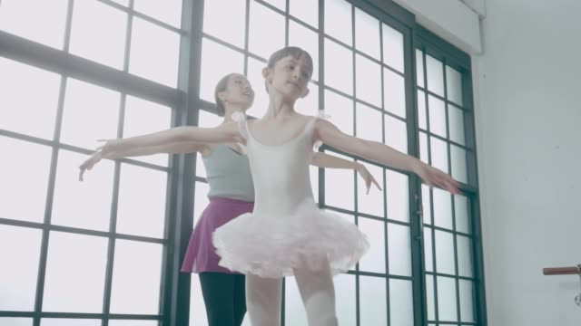 ballet coach teaching cute mixed-race girl in dance studio with positive emotion - leotard stock videos & royalty-free footage