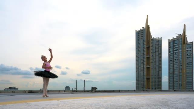 ballet cute girl dancer in black tutu posing on rooftop. - tutu stock videos & royalty-free footage