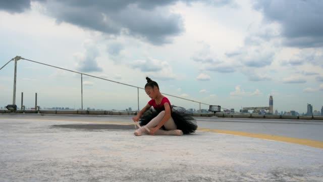 ballet cute girl dancer in black tutu preparing on rooftop. - tutu stock videos & royalty-free footage