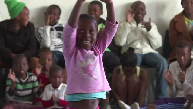a ballet dance group performed to an audience of children from a township and also taught them some moves on saturday as south africa celebrated... - annual event stock videos and b-roll footage