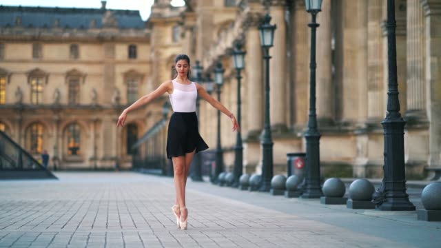 ballet dancer amanda derhy performs a various dance moves, wears a white leotard, repetto ballerina shoes and a light purple skirt, in front of the... - leotard stock videos & royalty-free footage