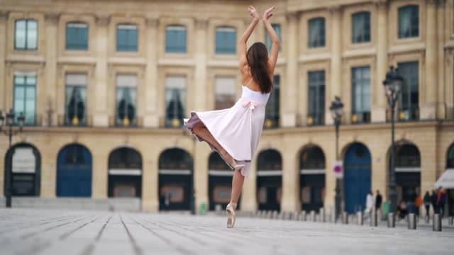 ballet dancer amanda derhy performs several ballet dance moves wears a white leotard ballet shoes and a light purple skirt at place vendome on march... - ballet dancer stock videos & royalty-free footage