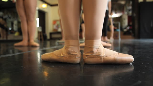 cu ballet dancer class with her feet in the first position / chicago, illinois, usa - ballettschuh stock-videos und b-roll-filmmaterial