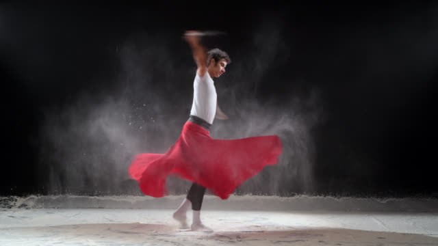 ballet dancer dancing with powder snow at studio. slow motion - pirouette stock videos and b-roll footage