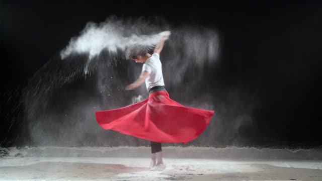 ballet dancer dancing with powder snow at studio. - pirouette stock videos and b-roll footage