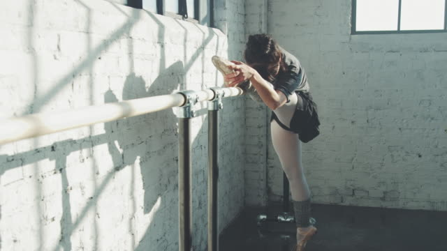 ballet dancer stretching in studio - barre stock videos & royalty-free footage
