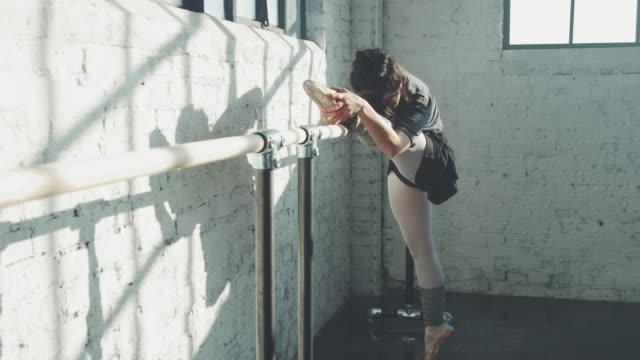 ballet dancer stretching in studio - ballet studio stock videos & royalty-free footage