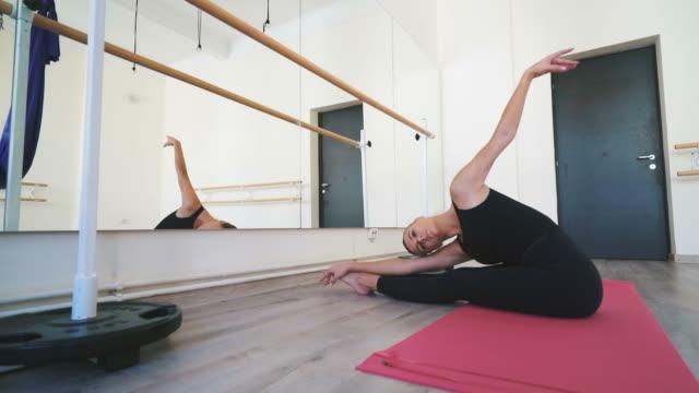 ballet dancer stretching. - ballet studio stock videos & royalty-free footage
