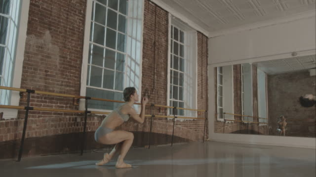 Ballet dancers in dance studio rehearsing together