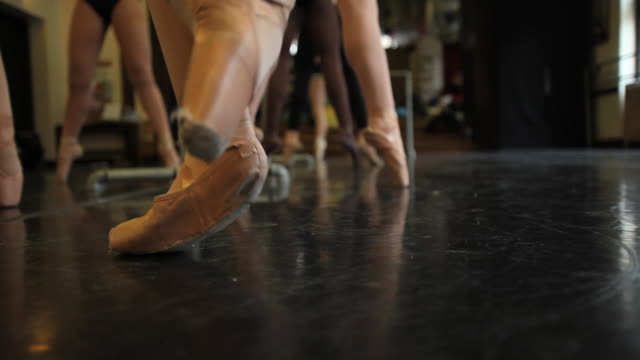 cu ballet dancers perform pointe work with various feet positions during class / chicago, illinois, usa - ballettschuh stock-videos und b-roll-filmmaterial