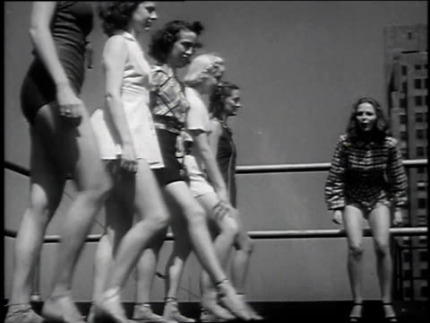 1939 montage ballet dancers race en pointe on top of building / chicago, illinois, united states - ballet shoe stock videos and b-roll footage