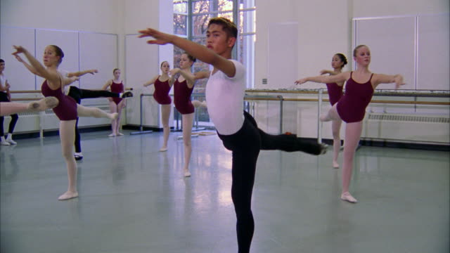 ballet dancers slowly turn while pointing one foot. available in hd. - ballet dancing stock videos & royalty-free footage