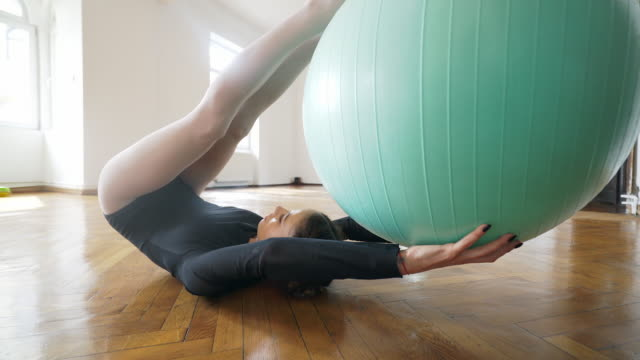 ballet fit ball. - fitness ball stock videos and b-roll footage