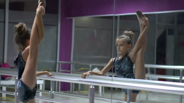 ballet girl building flexibility of the barre - dance studio stock videos & royalty-free footage