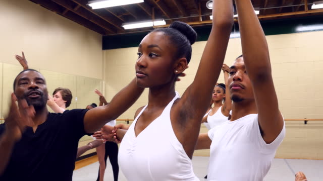 ms ballet instructor helping students with form during class in studio - ballet dancer stock videos & royalty-free footage