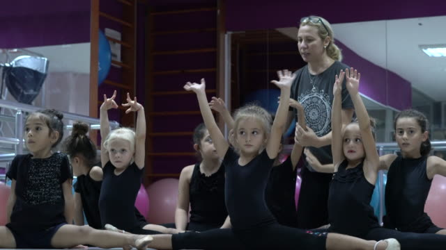 ballet instructor teaches ballet in school class - doing the splits stock videos & royalty-free footage