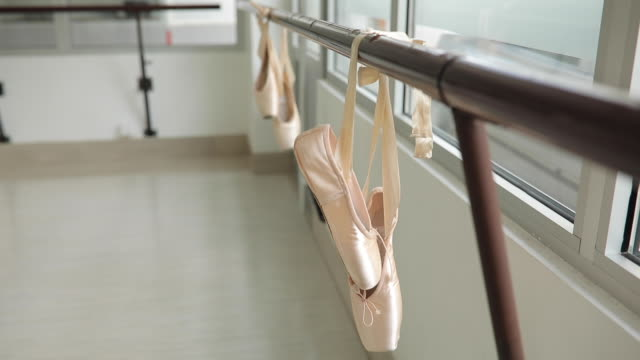 ballet shoes hanging on a barre - barre stock videos & royalty-free footage