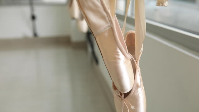 ballet shoes hanging on pole - ballet shoe stock videos and b-roll footage