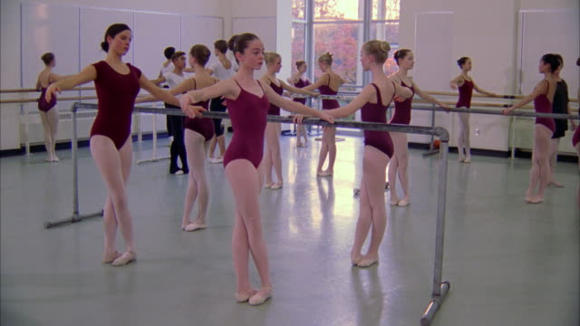 ballet students practice at a bar inside a studio. available in hd. - dance studio stock videos & royalty-free footage