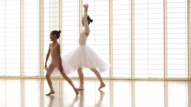 ws ballet teacher dancing with young student. - ballettschuh stock-videos und b-roll-filmmaterial