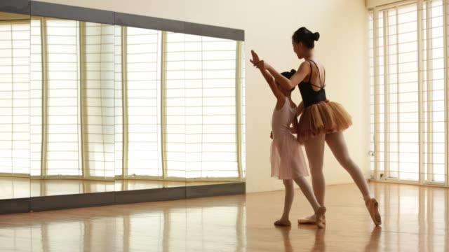 ws ballet teacher teaching young ballerina to dance in front of a mirror. - preschool stock videos and b-roll footage
