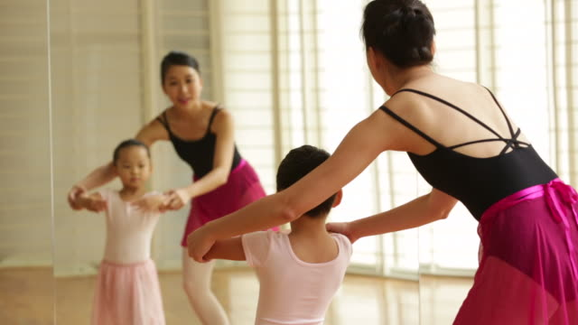 ms ballet teacher teaching young dancer. - insegnante video stock e b–roll