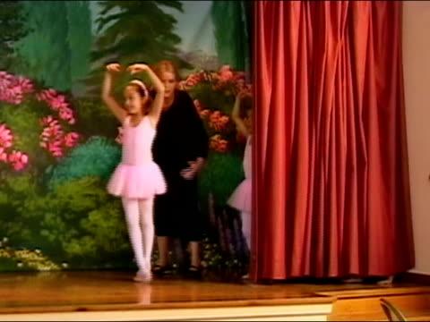 ballet teacher ushering girls onto stage during dress rehearsal / girls dancing / los angeles, california - pacific islander teacher stock videos & royalty-free footage