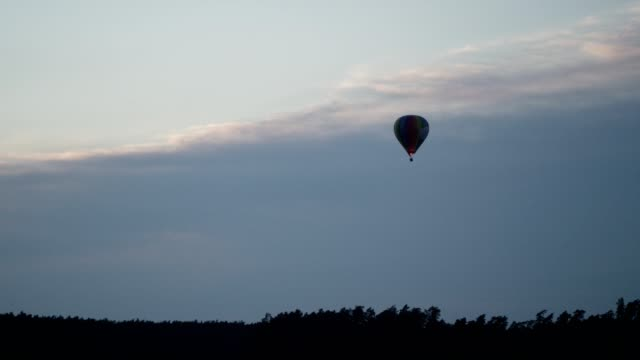 balloon floating above lake. romantic sunset - romantic sky stock videos & royalty-free footage