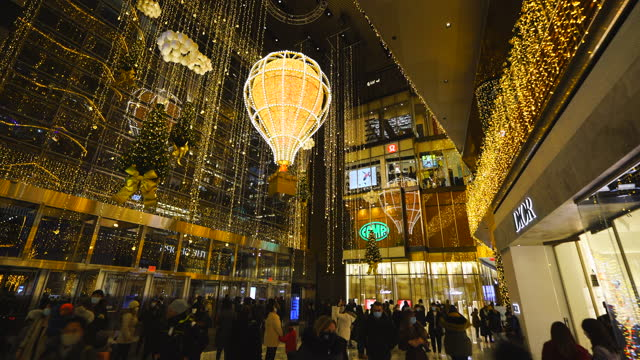 balloon glows in christmas colours at the entrance hall of hudson yards building, which is decorated by millions of christmas lights, amidst the... - weekday stock videos & royalty-free footage