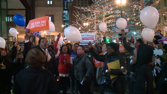 balloon release at 'moms demand action' anti-gun violence group gathering in chicago on december 11, 2015. - gun control stock videos & royalty-free footage