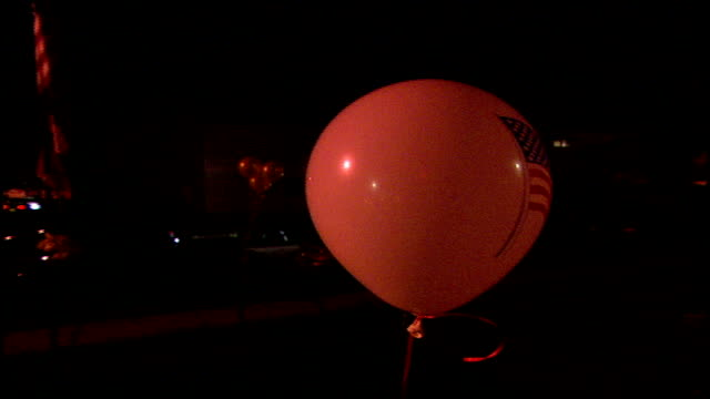 cu balloon with american flag on it for 9/11 victims in paterson nj - エディトリアル点の映像素材/bロール