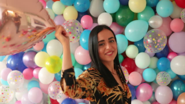 balloons always make her smile - surrounding stock videos and b-roll footage