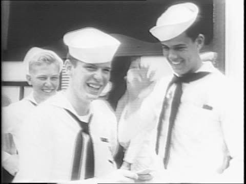 balloons and streamers on the deck of the uss south dakota with ships in the background / sailors on the deck looking at the hawaiian coastline /... - straw hat stock videos and b-roll footage