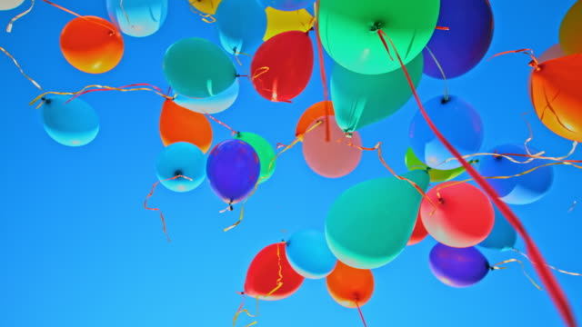 slo mo ld balloons floating into the clear blue sky - content stock videos & royalty-free footage