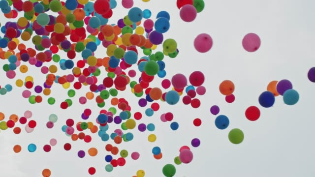 balloons flying into the sky - releasing stock videos and b-roll footage
